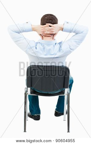 back view of business man sitting on chair.  businessman watching. Rear view people collection.  backside view of person.  Isolated over white background. Satisfied businessman sitting resting.