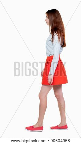 back view of walking  woman in red. beautiful blonde girl in motion.  backside view of person.  Rear view people collection. Isolated over white background.