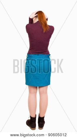 Back view of shocked woman in dress .   upset young girl. Rear view people collection.  backside view of person.  Isolated over white background. She closed her ears with her hands.