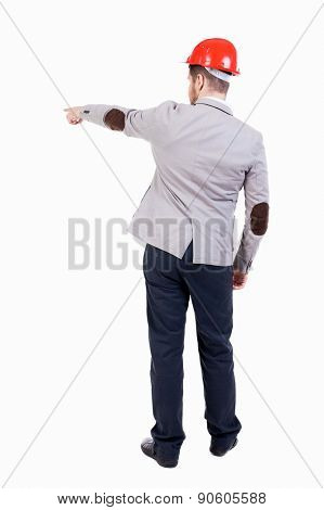 Back view pointing young men in helmet. Young guy  gesture. Rear view people collection.  backside view of person. Isolated over white. bearded businessman at a construction site gives instructions