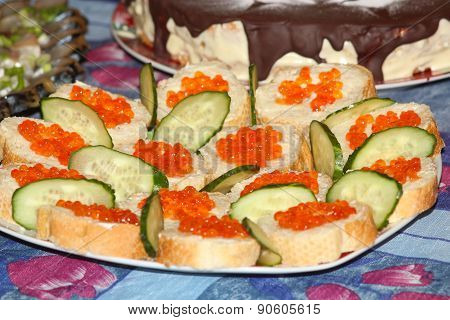 Sandwich With Red Caviar And Cucumber