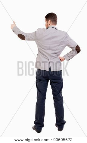 Back view business man shows thumbs up.  Isolated over white background. office worker with two hands showing symbol of success. Putting his hand on the waist, other hand businessman showing his thumb