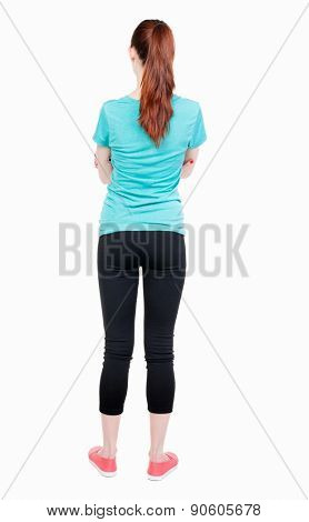 back view of standing young beautiful  woman. girl  watching. Rear view people collection.  backside view of person.  Isolated over white background. athlete stands with his arms folded.