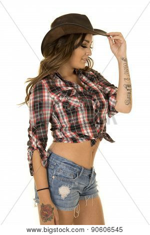 Cowgirl With Tattoo And Hat Side Look Down