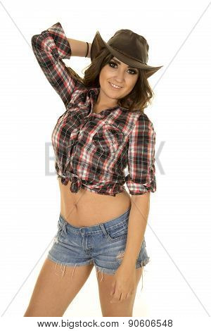 Cowgirl With Tattoo And Hat Smiling