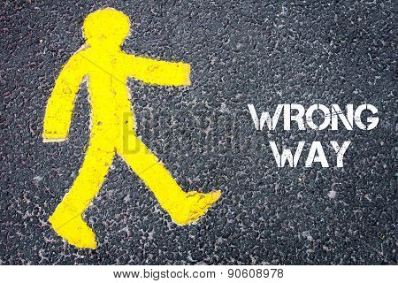 Yellow Pedestrian Figure Walking Towards Wrong Way