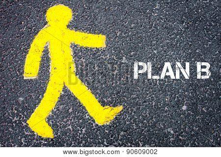 Yellow Pedestrian Figure Walking Towards Plan B
