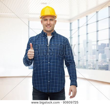 repair, construction, building, people and maintenance concept - smiling male builder or manual worker in helmet showing thumbs up