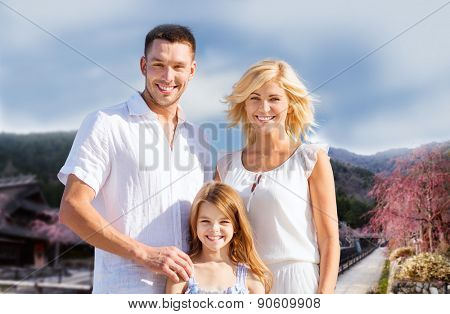 summer holidays, travel, tourism and people concept - happy family over hills background