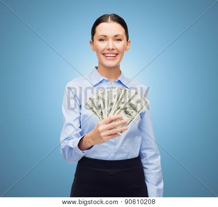 business and money concept - young businesswoman with dollar cash money over blue background