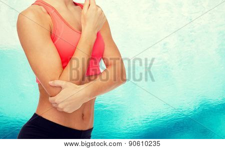 healthcare, fitness and medicine - sporty woman with pain in elbow