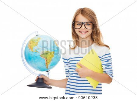 education and school concept - smiling little student girl with globe, notebook and black eyeglasses