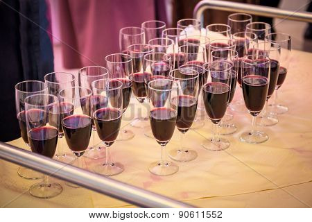 Glasses with red champagne on the party table