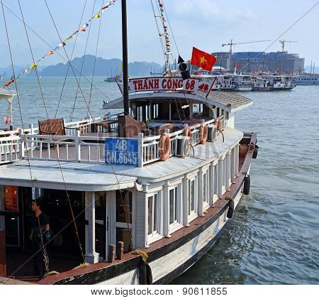 Large White Tourist Boat Departs Halong Bay Marina
