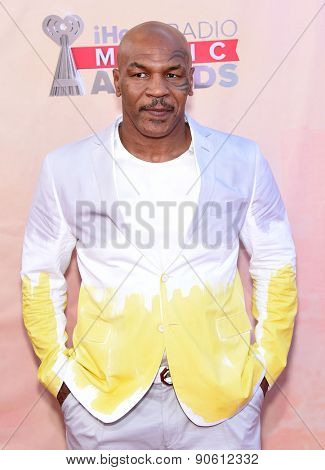 LOS ANGELES - MAR 29:  Mike Tyson arrives to the 2015 iHeartRadio Music Awards  on March 29, 2015 in Hollywood, CA