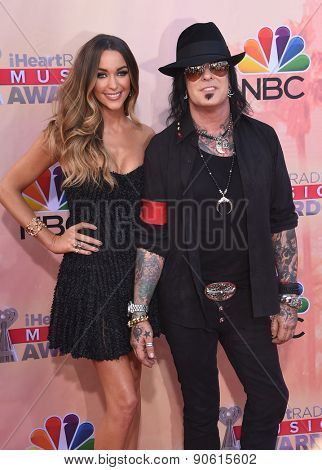 LOS ANGELES - MAR 29:  Nikki Sixx & Courtney Bingham Sixx arrives to the 2015 iHeartRadio Music Awards  on March 29, 2015 in Hollywood, CA