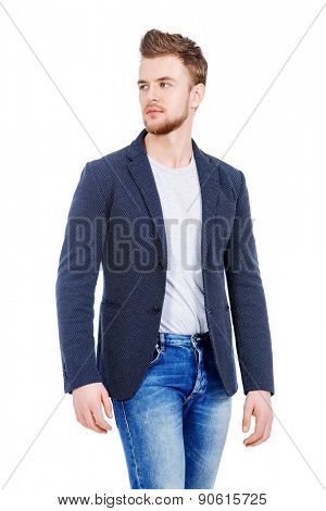 Casual young man wearing jeans and jacket posing at studio. Men's beauty, fashion. Isolated over white.