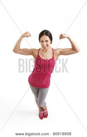 view from above of smiley woman showing her biceps and looking at camera. isolated on white background