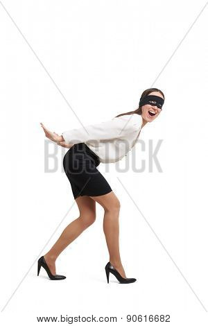 businesswoman in black mask holding her hands like carrying something. isolated on white background