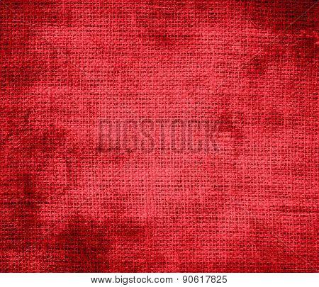 Grunge background of alizarin crimson burlap texture