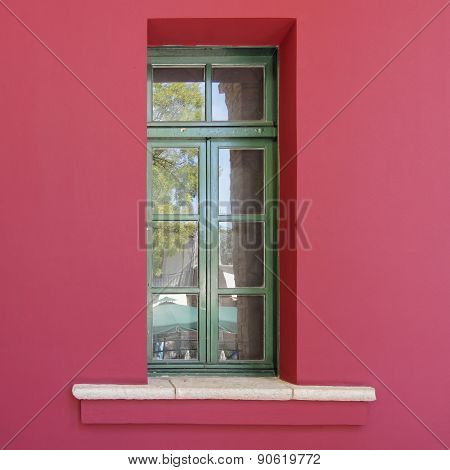green window red wall