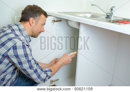Worker fitting a kitchen
