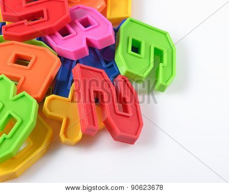 Colorful Plastic Numbers On A White