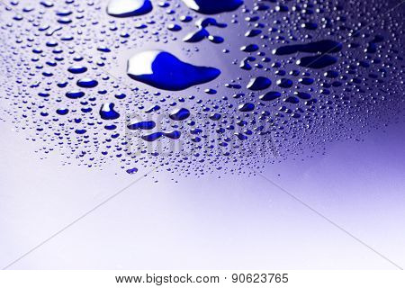Water Droplets On Blue Number Three