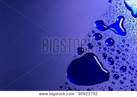 Water Drops On Bright Blue Paint Surface