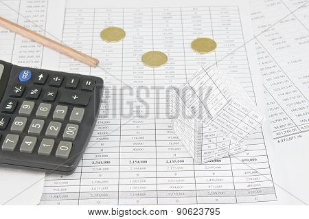 Bankruptcy Of House Near  Gold Coins And Calculator With Pencil