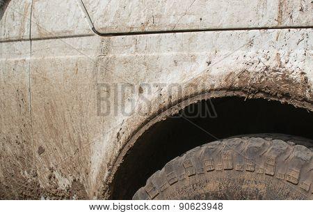 Muddy White Off Road Vehicle