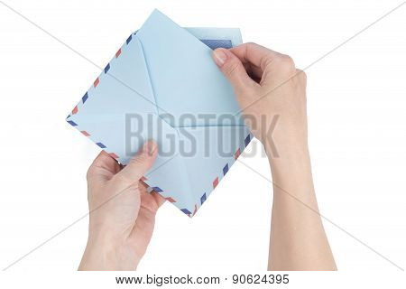 Female Hand Pulls A Letter Out Of The Envelope Airmail