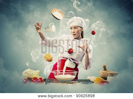 Bewitching Cook Is Making The Magician Dish On A Kitchen.