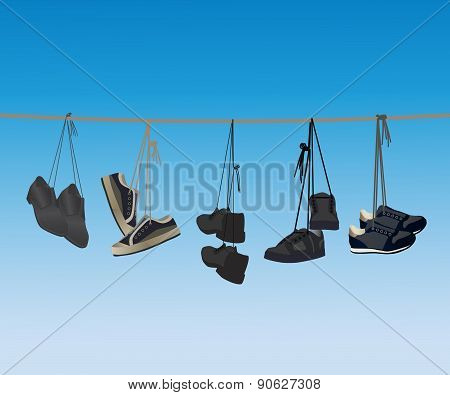 The Footwear Hanging On A Rope.