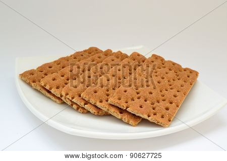 Dietary Bread On A White Plate On A White Background