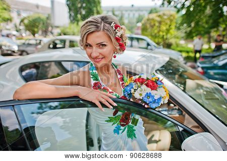 Blonde Bride In Traditional Dress Near Exotic Supercar