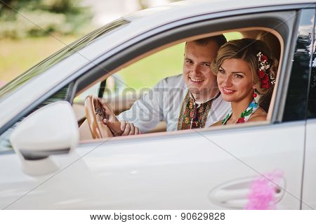 Wedding Beautiful Couple In Traditional Dress In Exotic Supercar