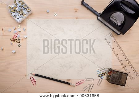 Office Supplies Arranged On A White Piece Of Paper