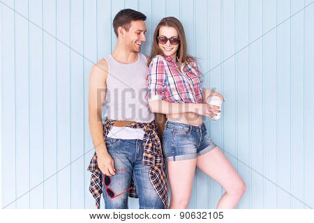 Happy couple friends wearing sunglasses in summer jeanswear street urban casual style talking having