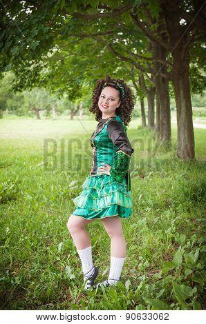 Young Beautiful Girl In Irish Dance Dress Posing Outdoor