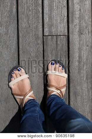 female legs in sandals