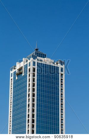 Blue Glass Office Tower With White Stone Corners