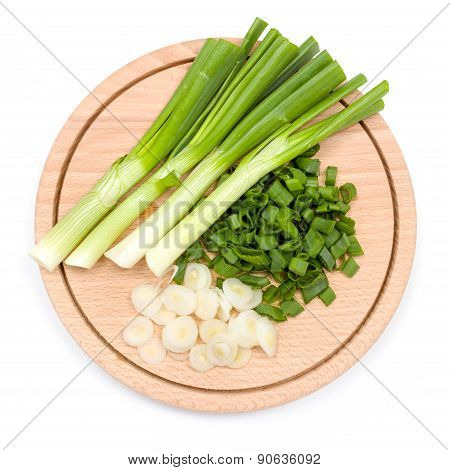 Freshly Cut Green Onion On Cutting Board
