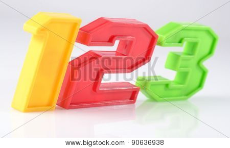 Colorful Plastic Numbers 123 On White