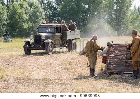NELIDOVO, RUSSIA- JULY 12, 2014: Battlefield 2014: Soviet army truck with soldiers in the back
