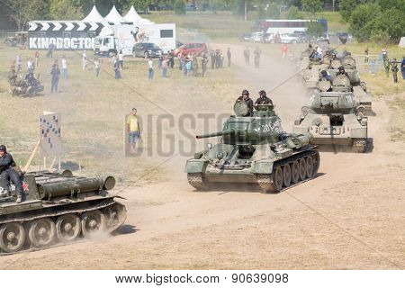 NELIDOVO, RUSSIA- JULY 12, 2014: Battlefield 2014: Soviet tank unit drives past spectators