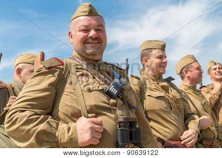 NELIDOVO, RUSSIA- JULY 12, 2014: Battlefield 2014: order of Soviet soldiers against the blue sky