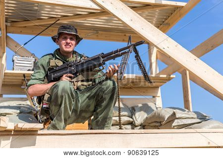 NELIDOVO, RUSSIA- JULY 12, 2014: Battlefield 2014: GI with the machine gun on observation tower