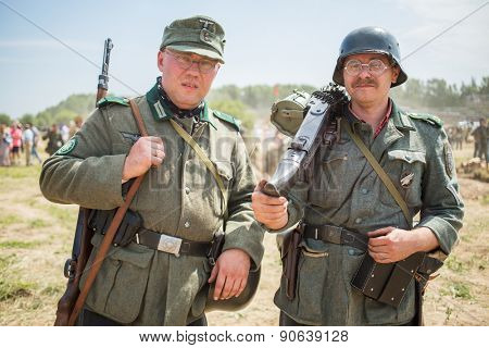 NELIDOVO, RUSSIA- JULY 12, 2014: Battlefield 2014: two Nazi soldiers in glasses with arms