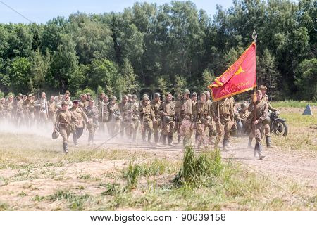 NELIDOVO, RUSSIA- JULY 12, 2014: Battlefield 2014: large group of Soviet soldiers going along the dusty road